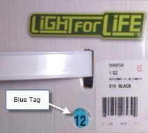 A small blue dot on the product packaging.
